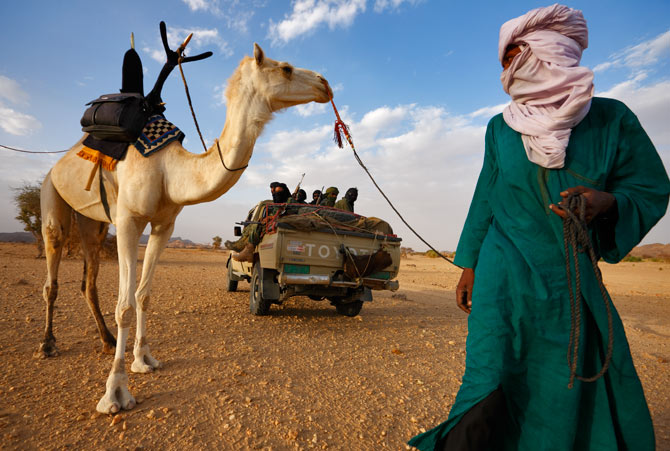 Tuareg tribesman alongside rebel fighters in the northern desert